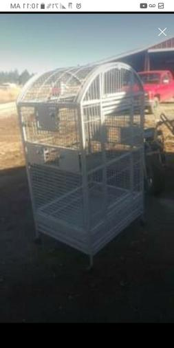 bird cage large, gray in color, with seed tray and wheels